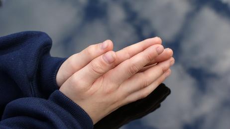 Child hands at prayer