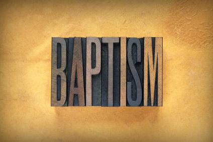 The word BAPTISM written in vintage lead letterpress type